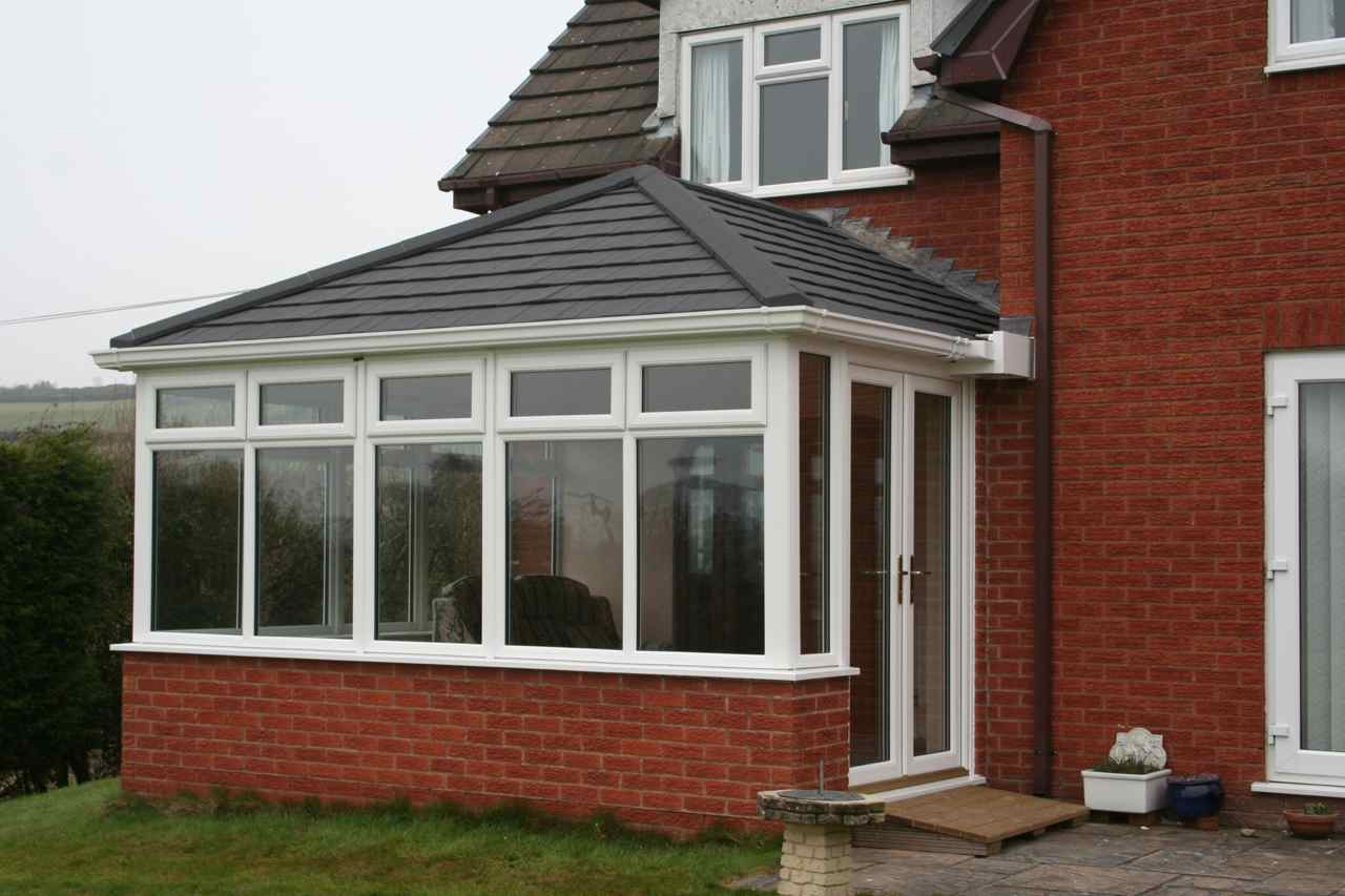 Artisan windows the new alternative solid conservatory for Glass rooms conservatories