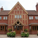 Artisan,Timber alternative/Oak effect Upvc, Oswestry